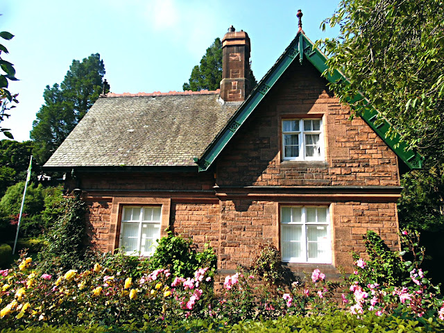 groundskeepers cottage with flowers in  summer