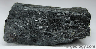 Sample of hornblende. The wood-like texture is visible in this sample.