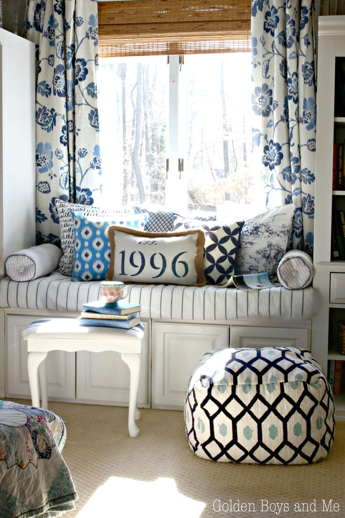DIY window seat made from upper kitchen cabinets with blue and white patterned throw pillows - www.goldenboysandme.com