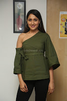 Pragya Jaiswal in a single Sleeves Off Shoulder Green Top Black Leggings promoting JJN Movie at Radio City 10.08.2017 058.JPG