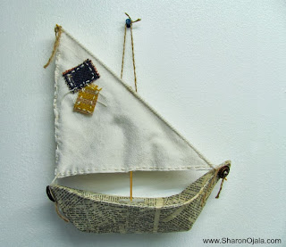 paper mache boat with fabric sail