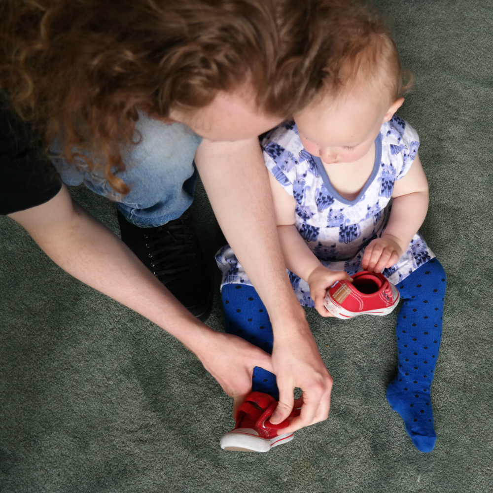 This Little Big Life: Steve putting Matilda's shoes on her
