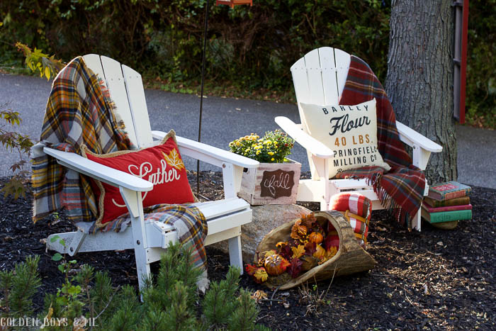 Adirondack chairs and fall decor with plaid blankets and books