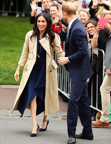 Meghan Markle wore a folded sail dress by Australian fashion designer Dion Lee, Martin Grant coat, Gucci Sylvie bag, Manolo Blahnik suede pumps
