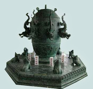 Chinese signaling infrasound receiver, ancient seismograph, cup with dragons, frogs opened mouth