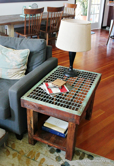 rustic industrial side table made from reclaimed wood and old grate
