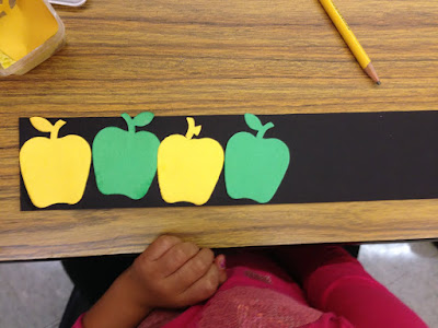 Make pattern using apple die cuts and black paper for a fun math activity