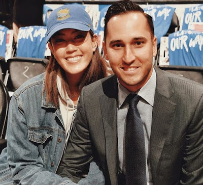 Michelle Wie and Jonnie West attend a Warriors game