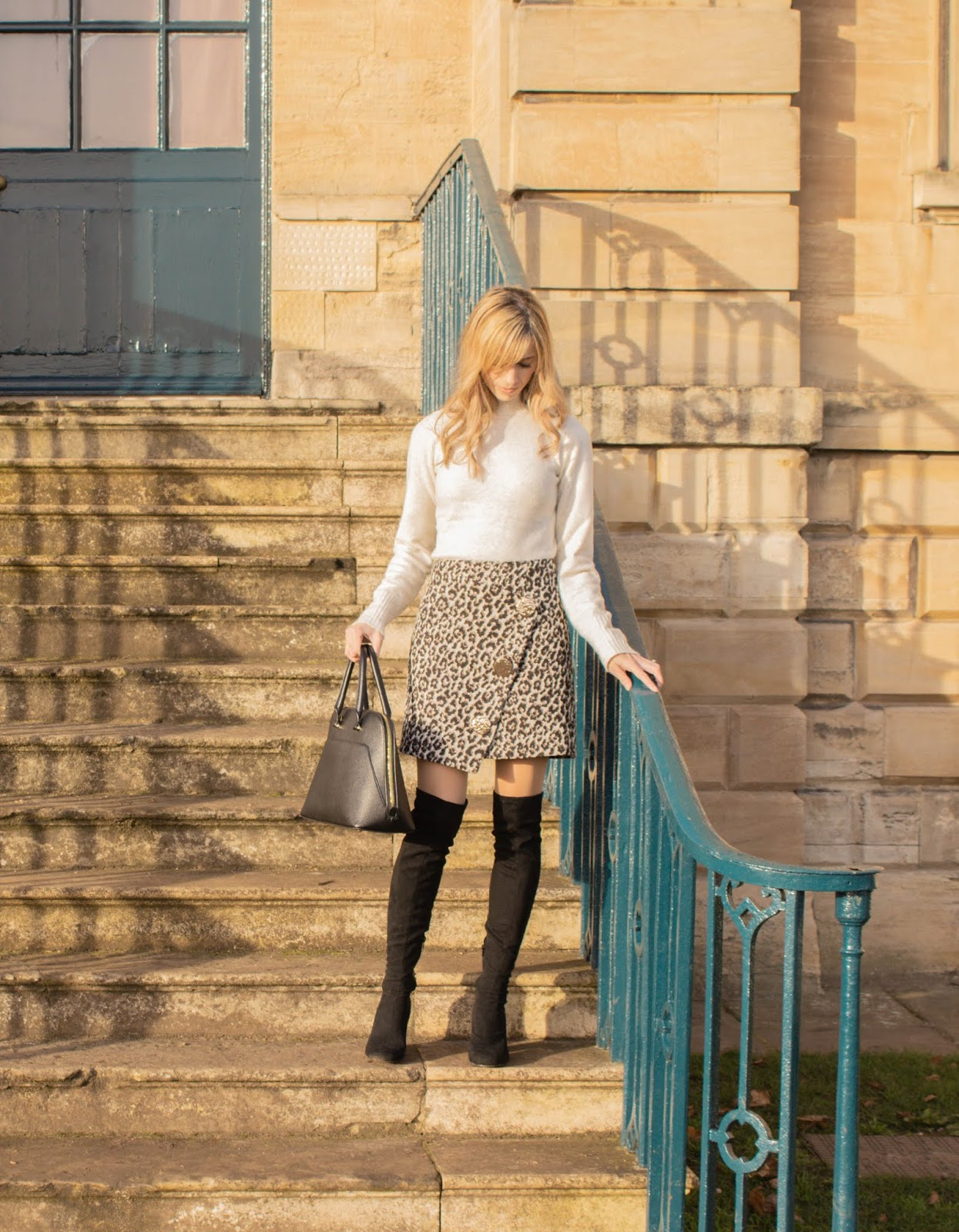 Mini skirt, turtle neck and over the knee boots outfit