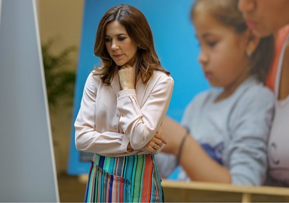 Crown Princess Mary of Denmark became Patron of World Health Organization/European Region in 2005. wore pattern line skirt and satin blouse