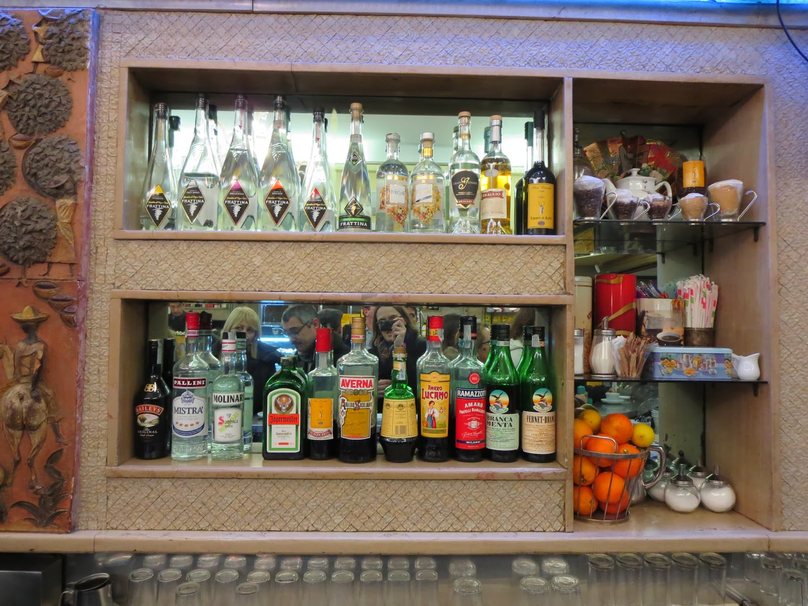 Liquor bottles at Sant'Eustachio Il Caffè in Rome, Italy