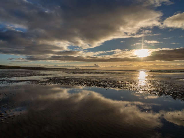 Photo of reflections in the wet sand on Maryport beach