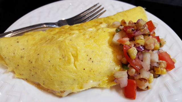 A Cheese Omelet with Grilled Corn and Tomato Relish