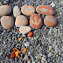 art on the beach with painted stones