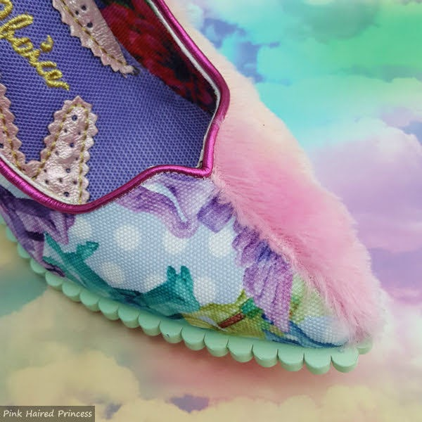 close up of pointed toe of shoe in split fluffy and unicorn fabrics with scalloped edge