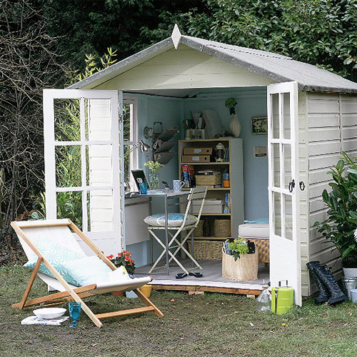 white garden shed with glass doors