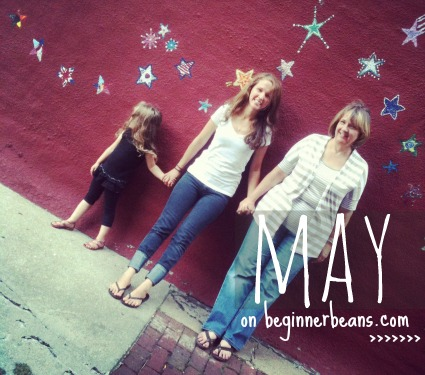 three generations standing in front of star-painted alley way