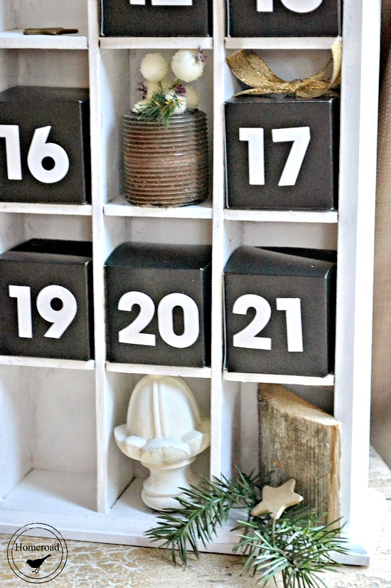 A DIY advent calendar using found pieces and boxes filled with candy.
