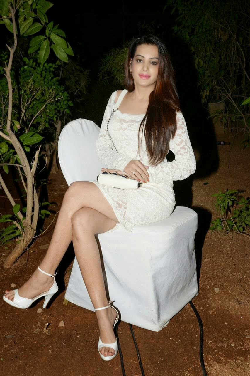 Actress Diksha Panth Audio Launch Stills, Actress Diksha Panth Crossleg Sitting Pics in White Dress from Event