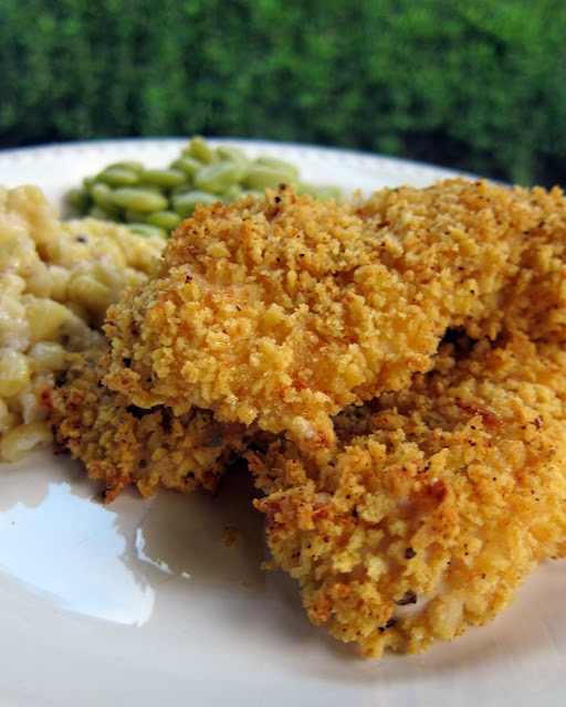 Waffle Crusted Chicken Tenders Recipe - Chicken & Waffles - coat chicken tenders in crumbled up waffles and bake. Can bread the chicken and freeze before baking for a quick weeknight meal. Drizzle with syrup for an extra kick! Kids love this recipe.