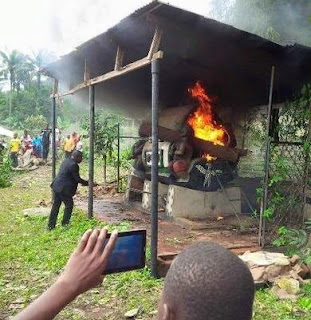 SHOCKING Photos of Ogun Pastor  TRANSFIXED At The Shrine While Razing It