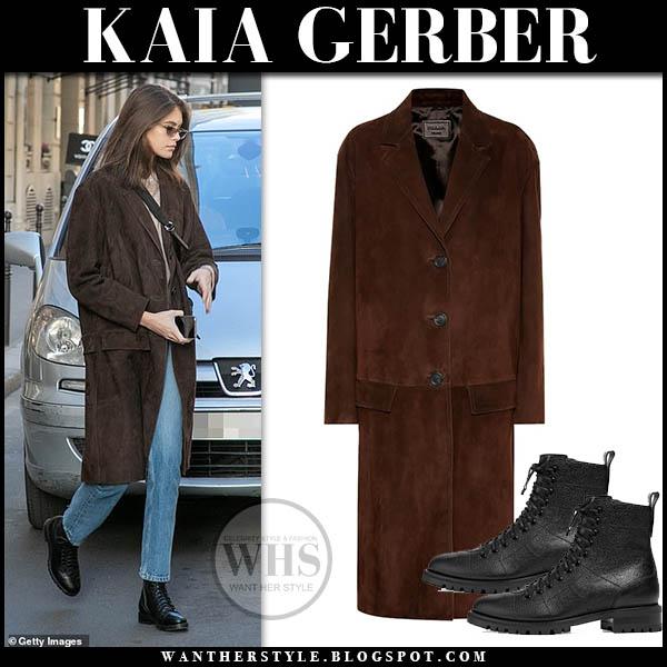 Kaia Gerber in brown suede prada coat, jeans and black jimmy choo cruz boots