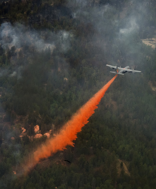 The 153rd Airlift Wing, Wyoming Air National Guard uses a Modular Airborne Fire Fighting System-equipped C-130 Hercules aircraft in support of the Waldo Canyon wild fire suppresion efforts near Colorado Springs, Colo on June 27, 2012. Four MAFFS-equipped aircraft, two from the 153rd and two from the Air Force Reserve Command's 302nd Airlift Wing flew in support of the U.S. Forest Service to fight fires in Colorado. (U.S. Air Force photo/ Staff Sgt. Stephany D. Richards)