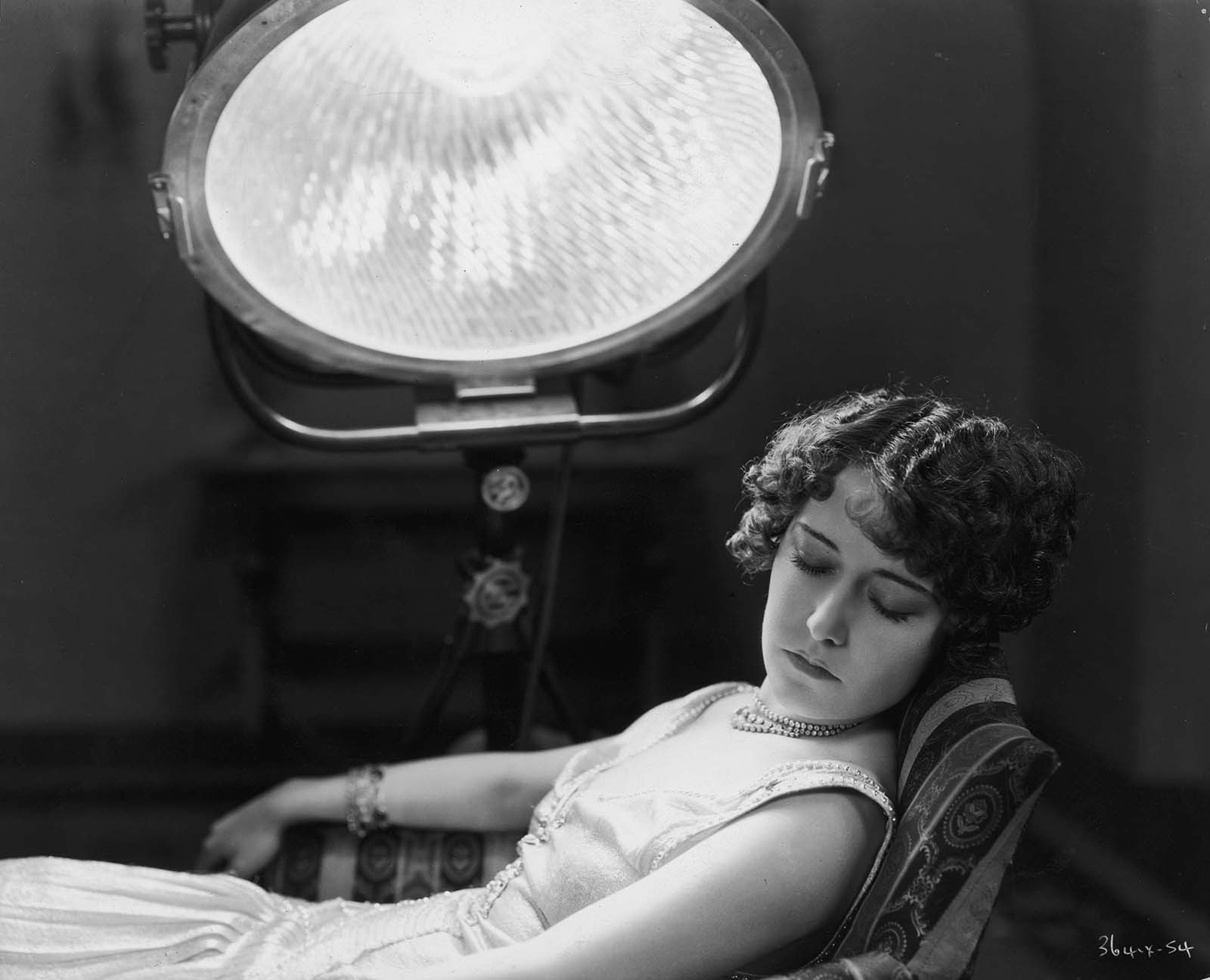 Hollywood film star, Dorothy Sebastian (1903 – 1957) undergoing treatment for bronchial congestion with a sun-ray lamp at MGM studios. 1930.