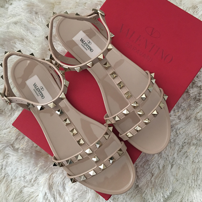 Valentino Rockstud PVC jelly flat sandals in poudre