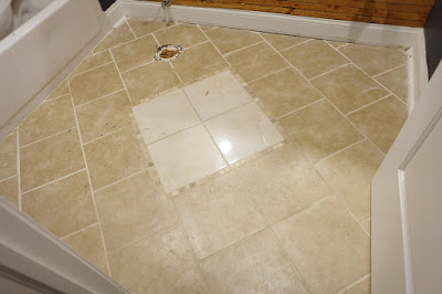 before photo bathroom ceramic tile floor