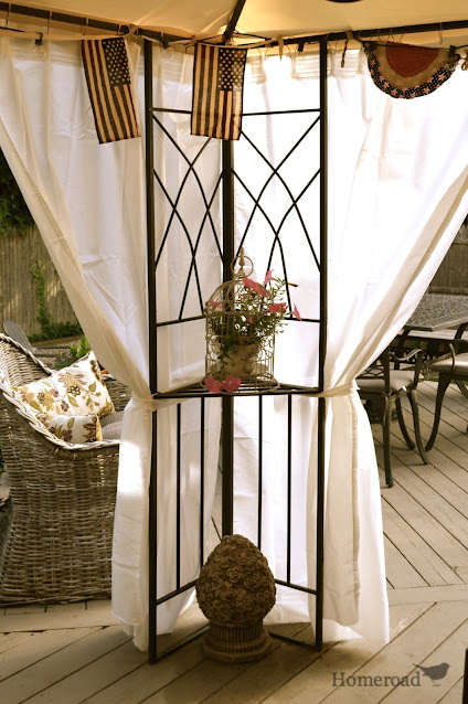 gazebo with flowing white curtains