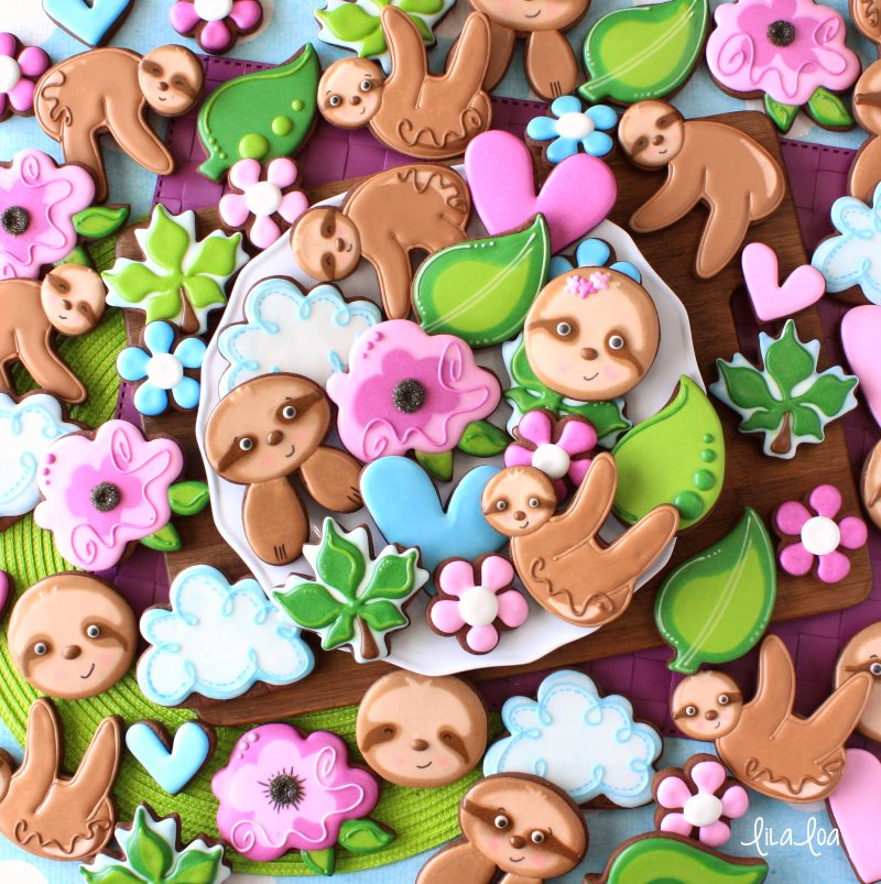 Sloth decorated chocolate sugar cookies - sloths in a jungle of cookies