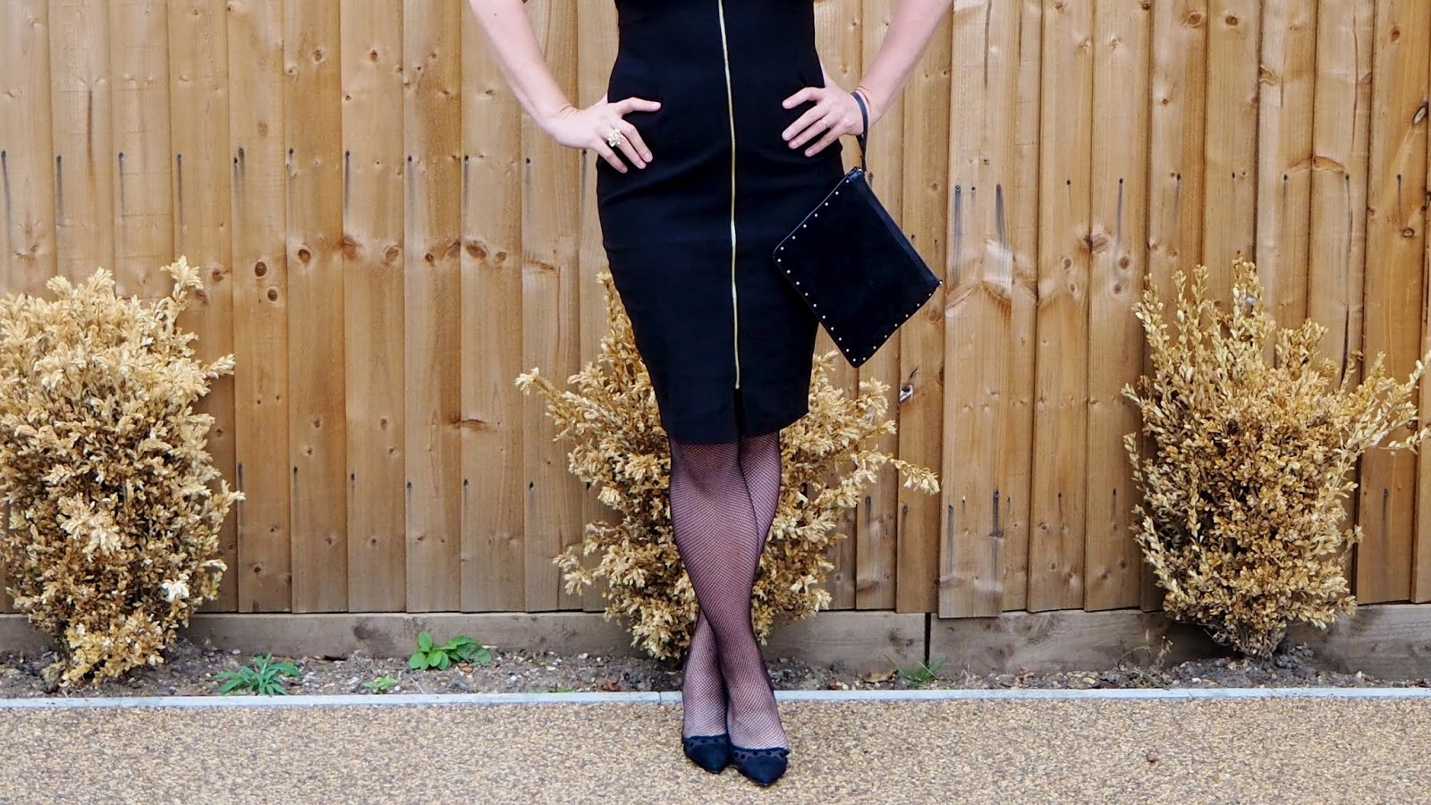 Black dress with gold zipper waist and skirt detail