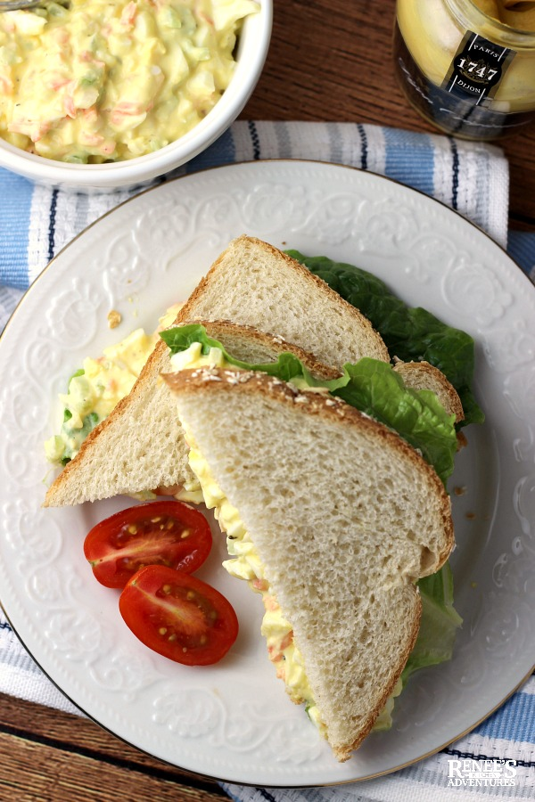 Egg Salad Sandwich on plate with bowl of egg salad