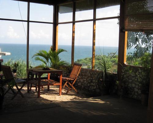Tinuku.com Villa Tirtasari sandstone and glass constructed on hilltops rocky coast Gunung Kidul to south sea views