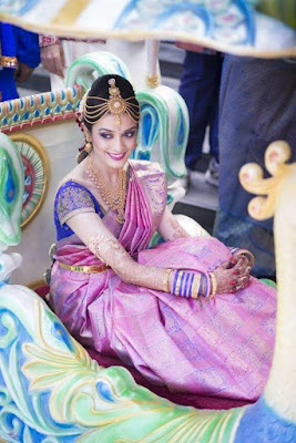 Beautiful South Indian Bride In Pink Silk Kanchipuram Saree With Gold Jewelry.