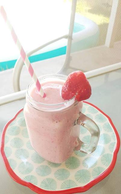 Frozen strawberry smoothie in mason jar by poolside