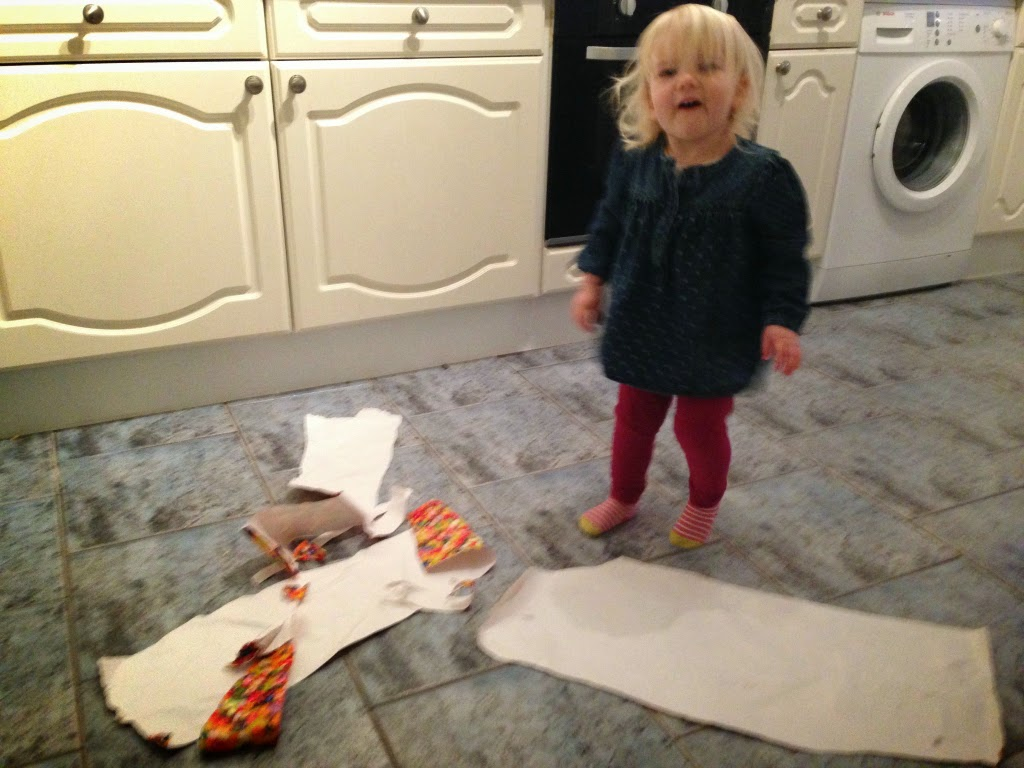 Tin Box Tot with ripped wrapping paper