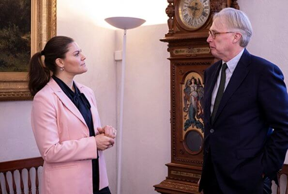 Stockholm Resilience Centre's science director and co-founder Carl Folke. Crown Princess Victoria wore Lexington Company pink blazer