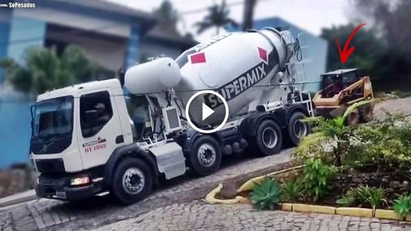carregadeira puxando caminhão