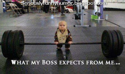 Baby lifting weights - what my boss expects from me!