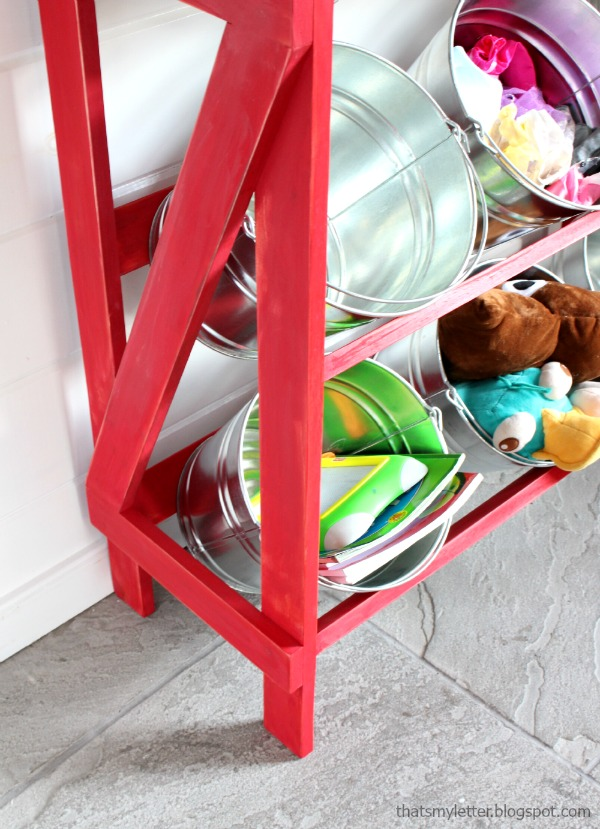 open shelving with galvanized buckets