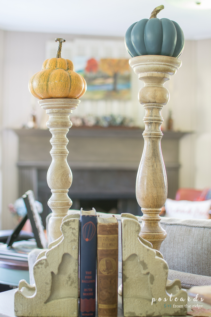 tall wood candlesticks with faux pumpkins