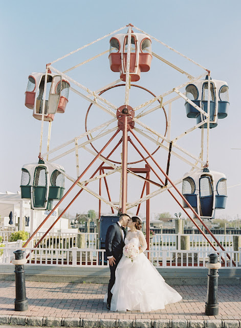 Jin and Christopher kiss in front of a ferris wheel before heading to Bridgeview Yacht Club
