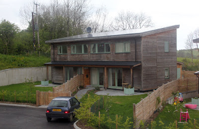 A pair of two-bedroomed semi-detached houses. All the homes have solar roofs.