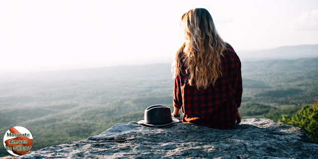 "Header image of the article: ""How To Set Goals For Yourself And Achieve Them"" - representing a girl sitted on a mountain thinking  about her life and setting goals"