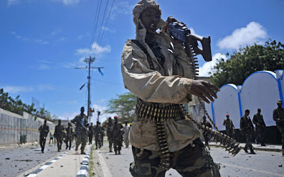 Hundreds of Ethiopian troops pulled out of a town in central Somalia Tuesday