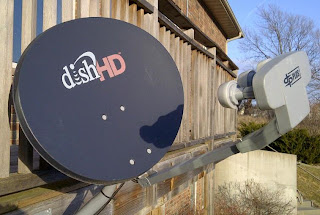 Dish Network satellite dish installed on wood deck