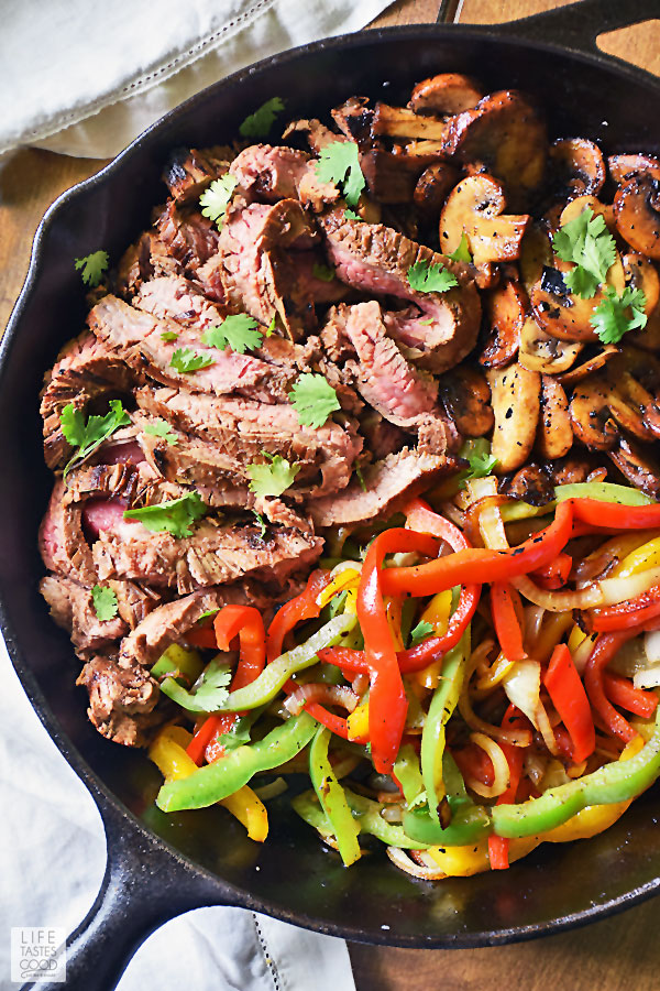 Flank Steak Fajitas Recipe - flank steak and veggies in cast iron skillet ready to eat