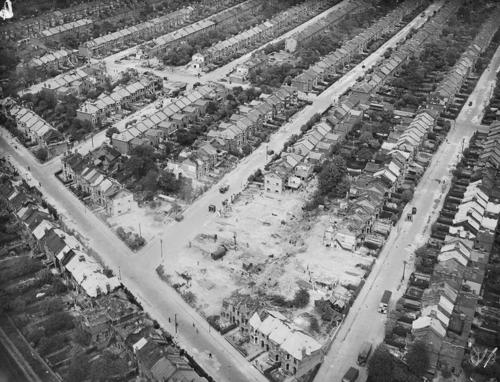 Houses are being cleared away in Essex after a V-2 explosion damaged and destroyed dozens of houses and killed nine people. 1945.